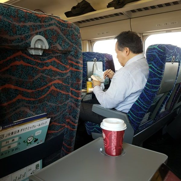 A man enjoying lunch on the train in Japan